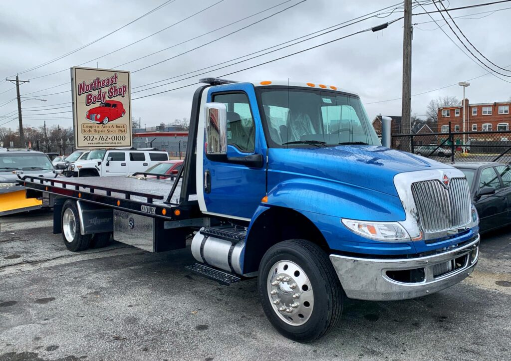 north-east-auto-body-shop-blue-tow-truck-
