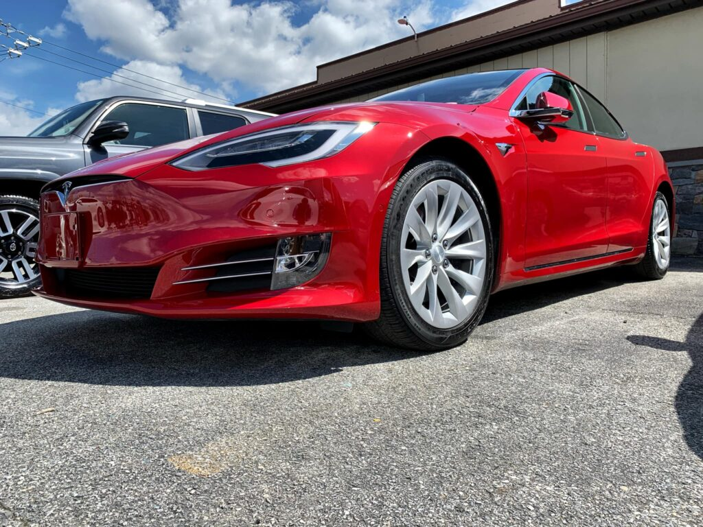 north east auto body shop red tesla sedan 5